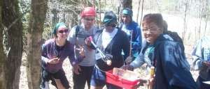 Expedition student team building adventure-happy college students retrieve egg
