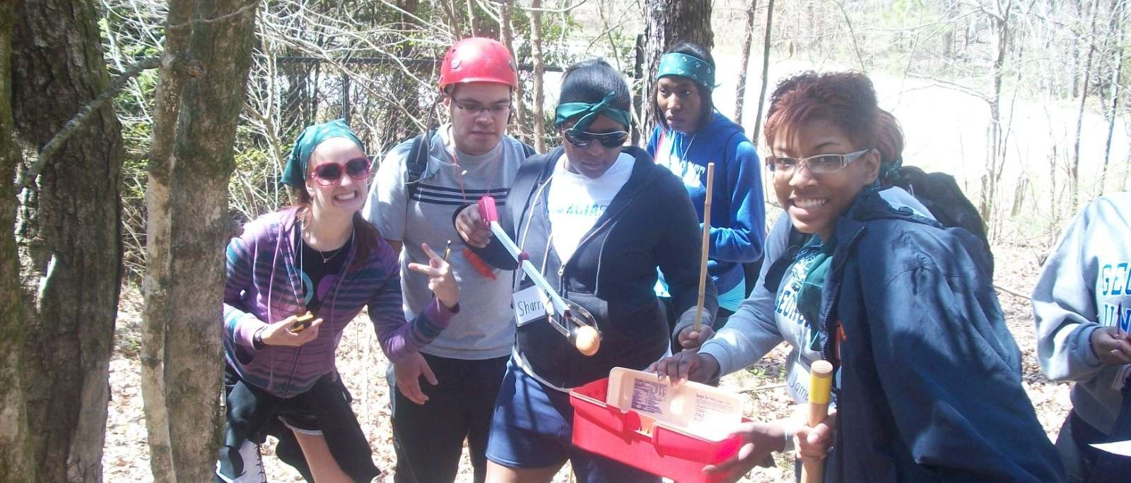 Expedition student team building adventure-happy college students retrieve egg