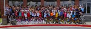 Operation Bicycle student team building event cheering students with bikes