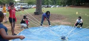 Race 4 Excellence student team building-cooperative lift heavy ball game
