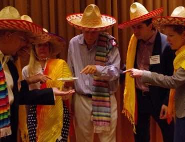 group with sombreros tasting food