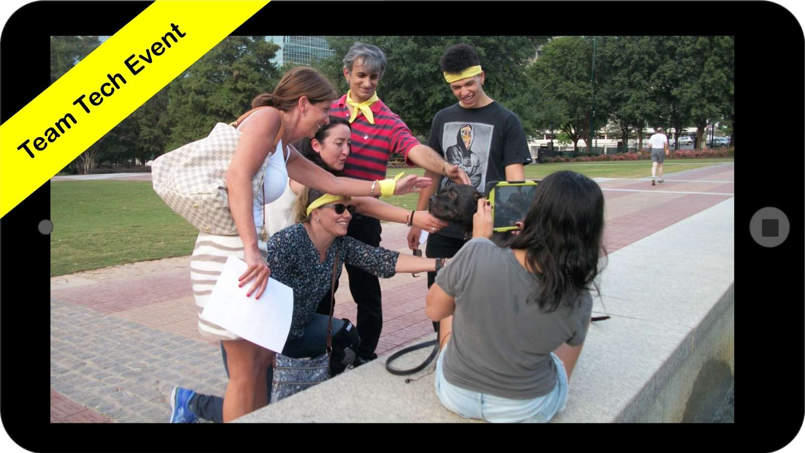 corporate scavenger hunt on mobile device. Team completes challenge with dog