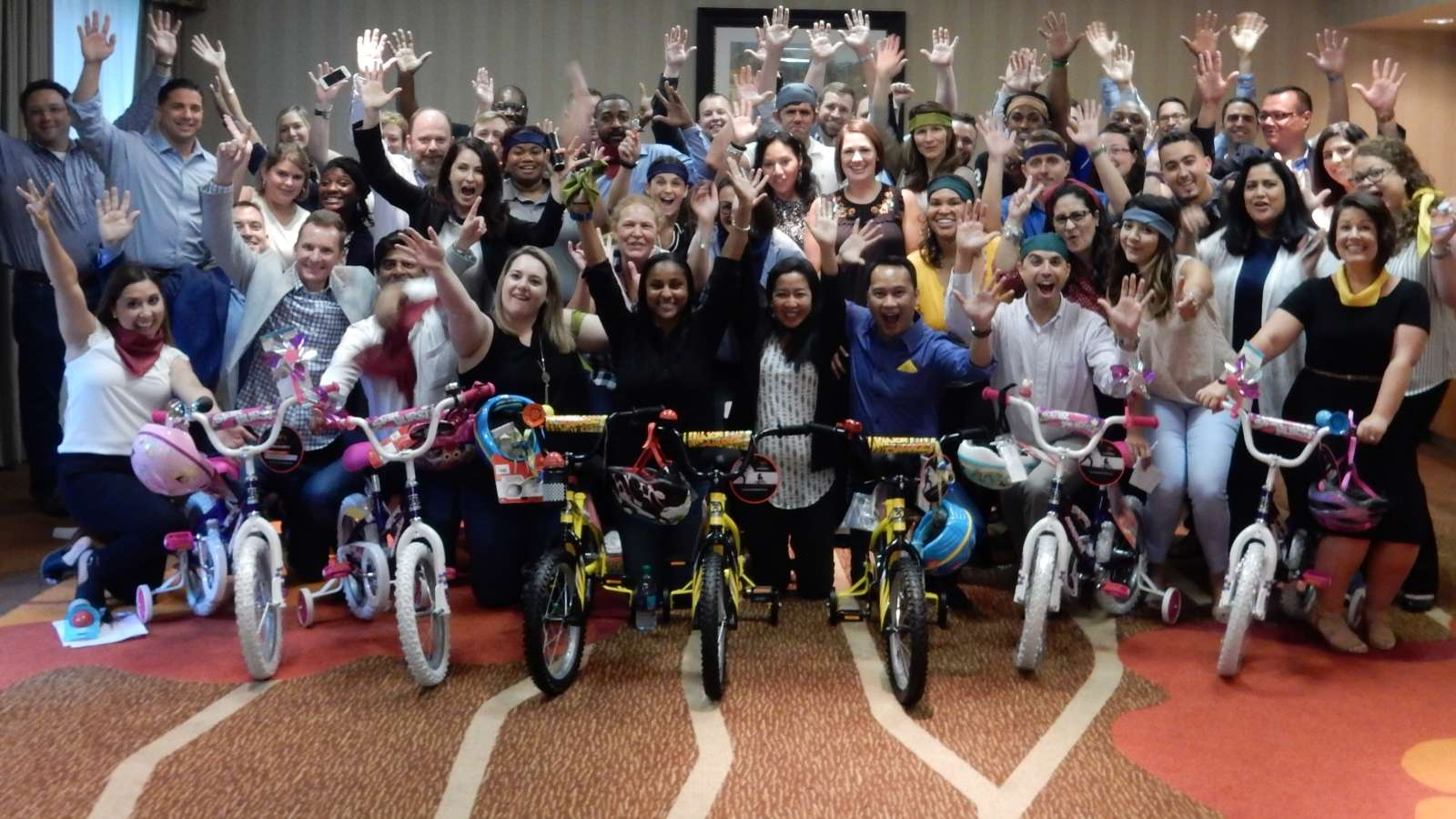 group cheers after bike charity team building