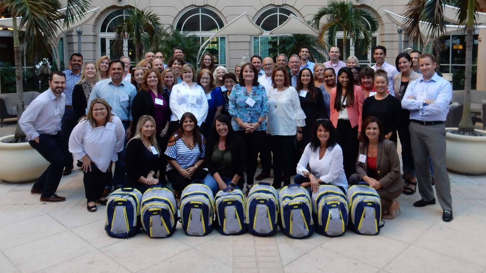 group with charity backpacks