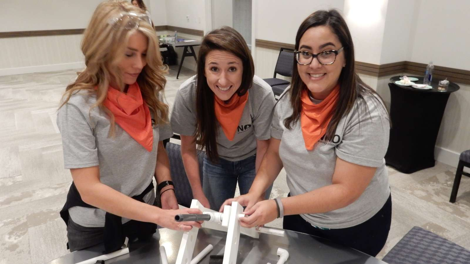 women building a catapult for team building