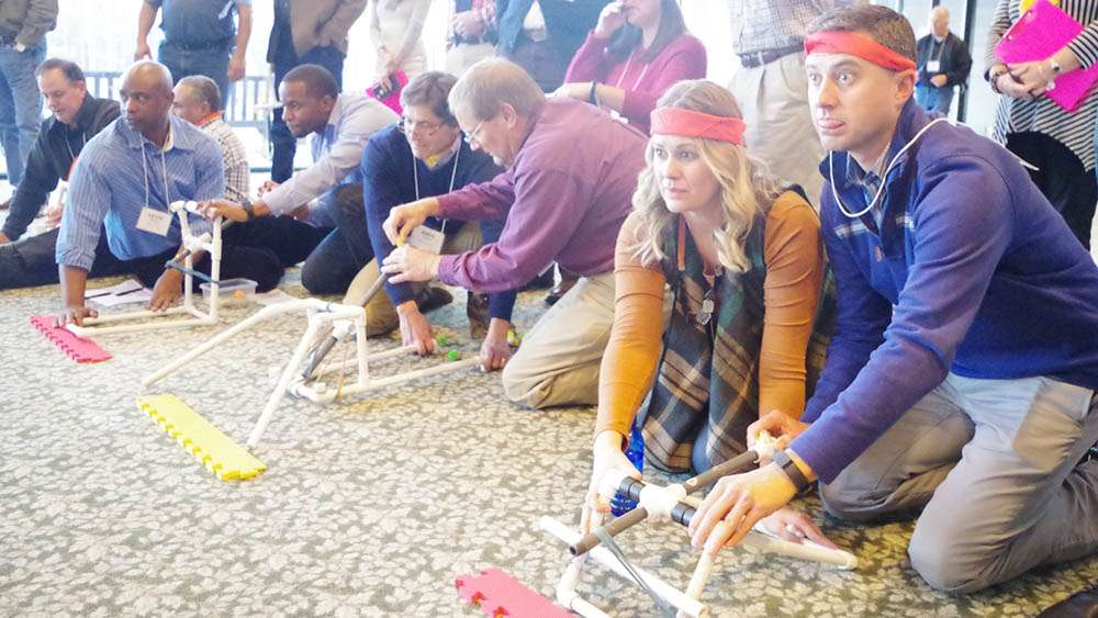 fun catapult team building for breaking down silos